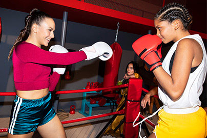 An image of two women boxing on board.