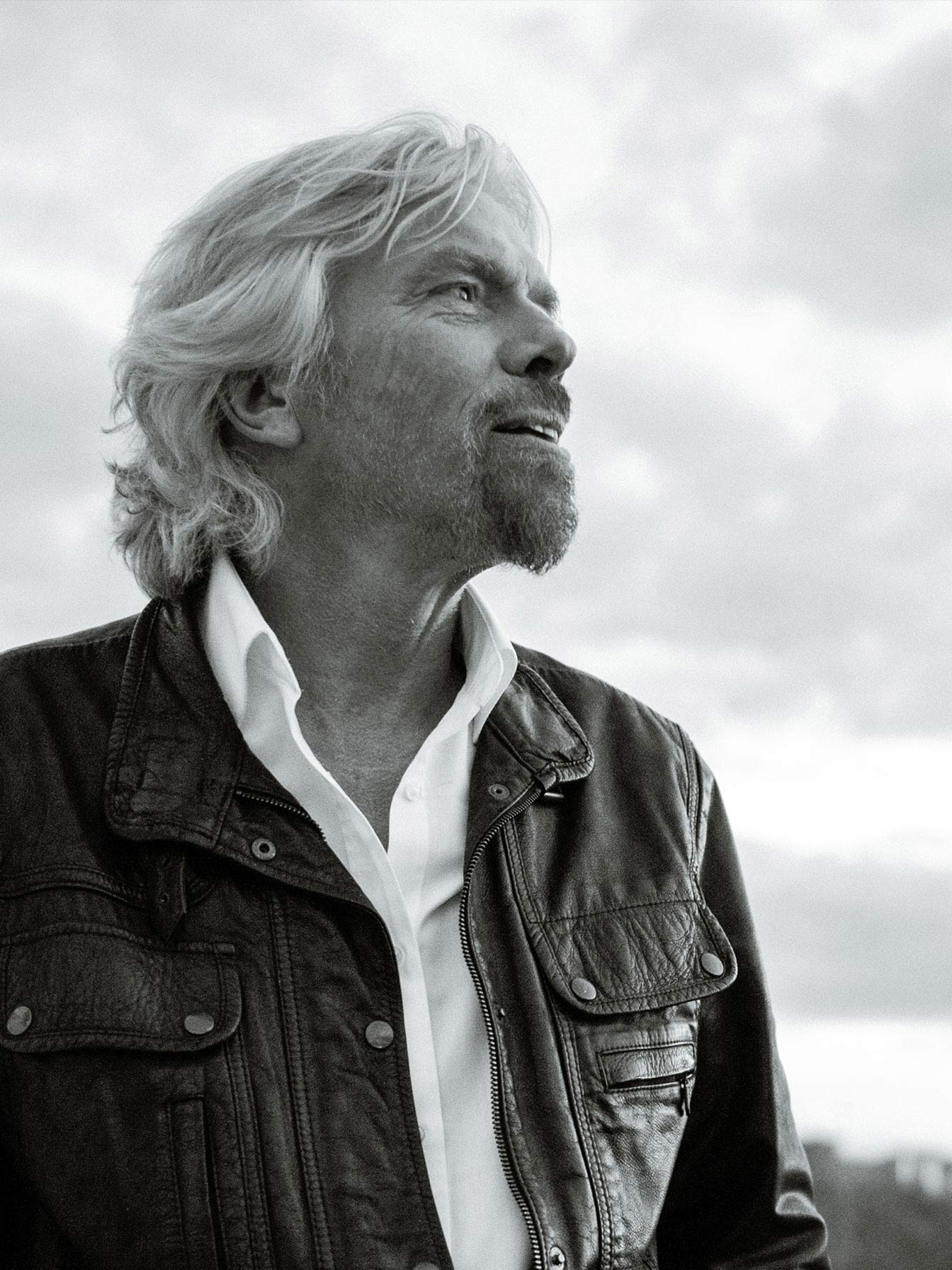A black and white portrait of Richard Branson.